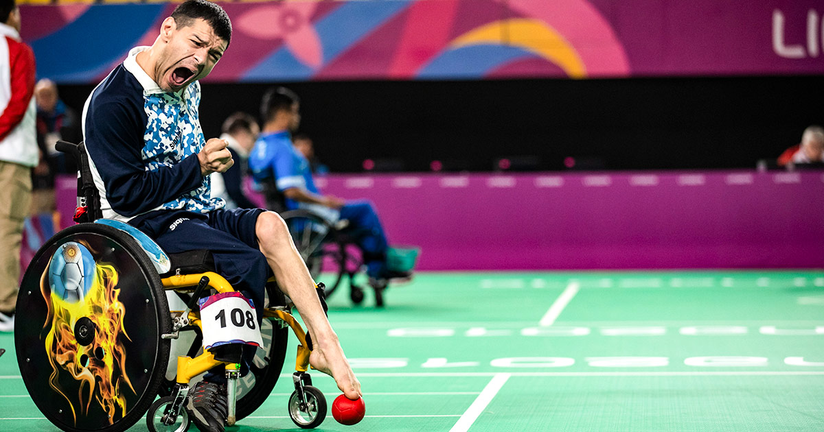Argentinian Para athlete Mauricio Ibarbure with the ball during the boccia competition at Lima 2019.