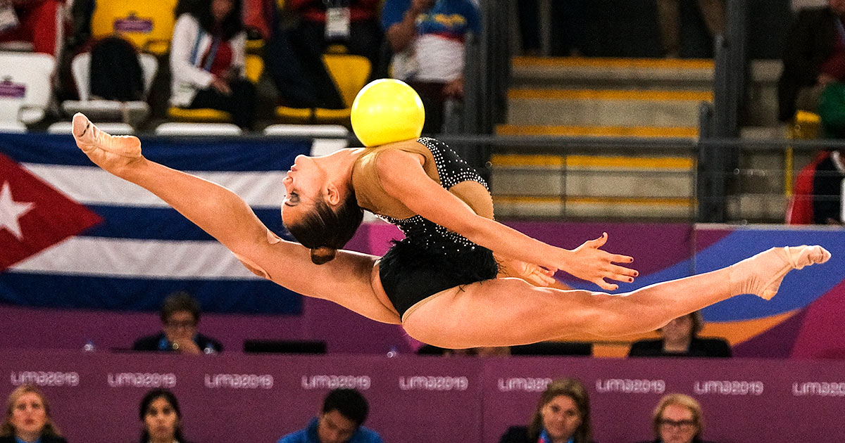 Cuban Gretel Mendoza of Cuba soars through the air with a ball in the rhythmic gymnastics' competition at Lima 2019.
