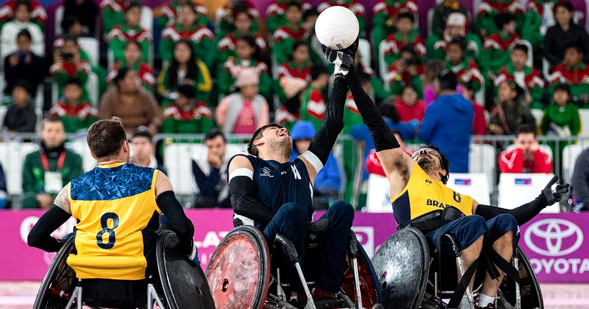 Wheelchair rugby teams from Brazil and Colombia fight for the ball to win the Lima 2019 bronze medal.