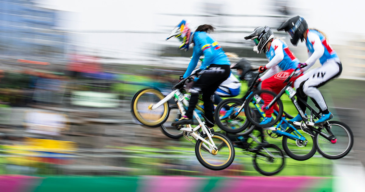 Female cyclists participate in the BMX final at Lima 2019.