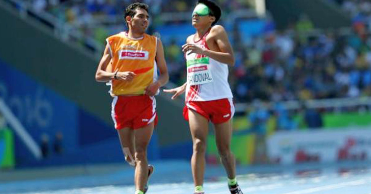 Luis Sandoval and his guide running during Para athletics competition at the Rio 2016 Paralympic Games