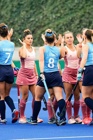 Argentinian and Uruguayan women's hockey teams greet each other before the game at Lima 2019