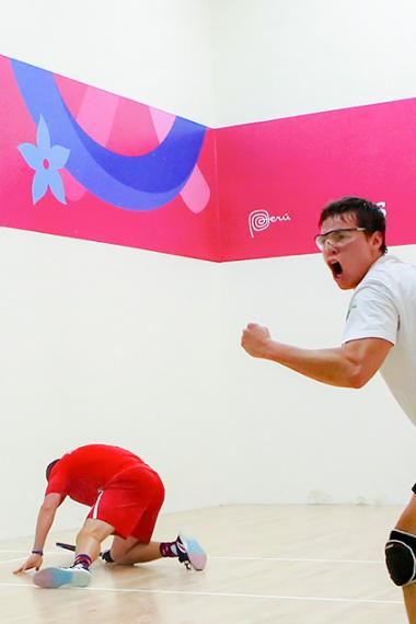 Bolivian Carlos Keller celebrates his victory over American Jacob Bredenbeck, who laid on the floor during the Lima 2019 racquetball semifinals at the Callao Regional Sports Village.