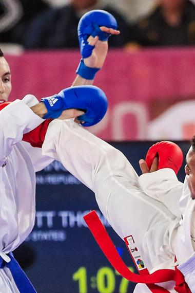 Anderson Soriano from the Dominican Republic competes against his US opponent, Thomas Scott, in karate at the Lima 2019 Games, at the Villa El Salvador Sports Center.
