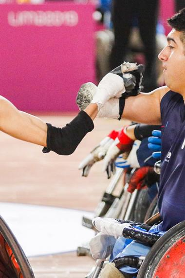 Lautaro Fernandez and Juan Herrera from Argentina play wheelchair rugby at the Lima 2019 Parapan American Games, at Villa El Salvador Sports Center
