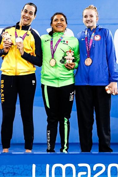 Mexico's Matilde Alcazar (gold), Brazil's Regina Nunes (silver) and USA's Laurie Hermes proudly posing with their 100 m breaststroke S11 medals at the National Sports Village – VIDENA, Lima 2019.
