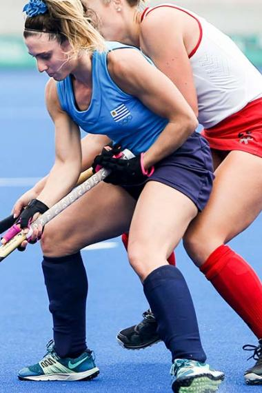 Uruguayan Camila De Maria passionately competing in a Lima 2019 hockey match against Canada at the Villa María del Triunfo Sports Center