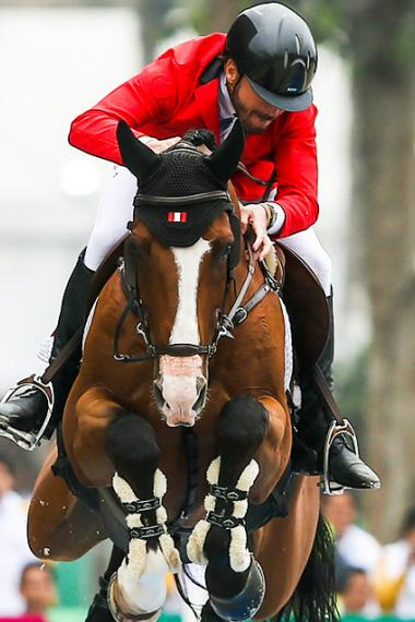 Alonso Valdez Prado of Peru participates in the Lima 2019 jumping final at the Army Equestrian School