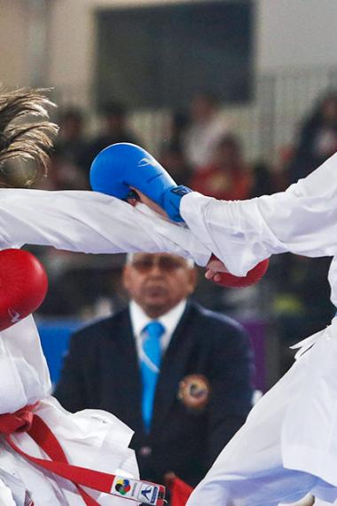 Mexican Alicia Hernández and Brazilian Jessica De Paula face off during the Lima 2019 karate competition at the Villa El Salvador Sports Center.