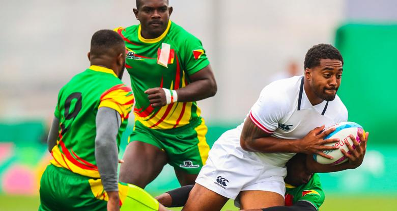 Guyanese rugby players try to knock Marcus Tupuola