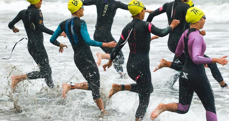 Group of athletes start triathlon competition at Chorrillos Beach