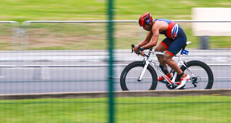 Michel Gonzales riding at top speed during the triathlon cycling event