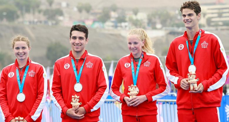 Canadians Charles Paquet, Alexis Lepage, Hannah Rose Henry and Desirae Ridenour show the medals they picked up in the triathlon