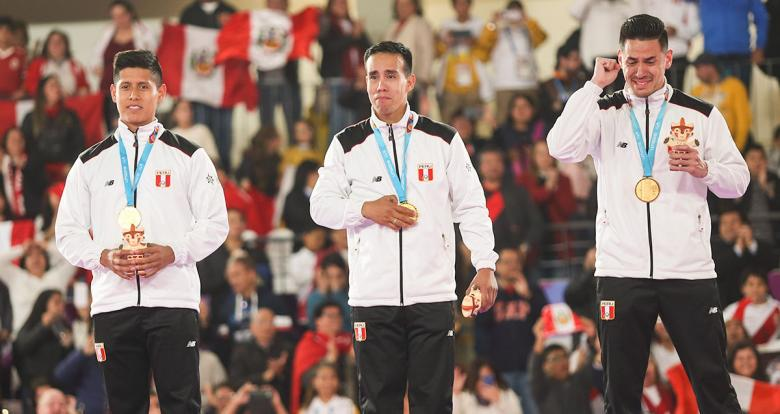 Peruvians Jhon Trebejo, Oliver del Castillo, and Carlos Lam burst into tears of joy after claiming the gold medals in Lima 2019 team karate kata event at the Villa El Salvador Sports Center