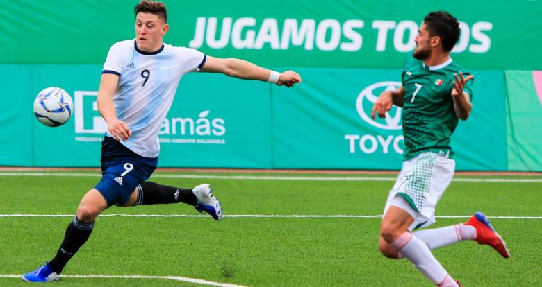 Julian Gaich (Argentina) and Paolo Martin (Mexico) face off in the Lima 2019 Pan American Games football competition at the stadium of the National University of San Marcos.