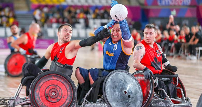 Canadian Patrice Dagenais and Brazilian Daniel Gonçalves fight for the ball in the Lima 2019 wheelchair rugby match at the Villa El Salvador Sports Center