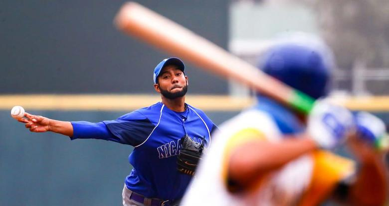Nicaraguan Jorge Bucardo faces the Colombian team in the Lima 2019 baseball competition at the Villa María del Triunfo Sports Center