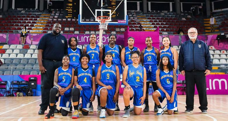 Virgin Islands women's basketball team posing for a picture before the Lima 2019 match against Colombia at the Eduardo Dibós Coliseum