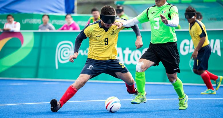 John González from Colombia during football 5-a-side match vs. Mexico at the Villa María del Triunfo Sports Center at Lima 2019.