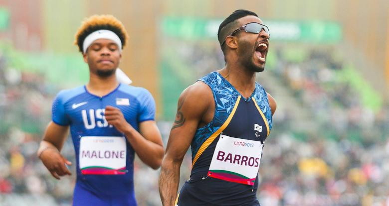 Brazilian Para athlete Fabrício Júnior Barros celebrates his victory in the Lima 2019 men's 100 m T12 competition at the National Sports Village - VIDENA