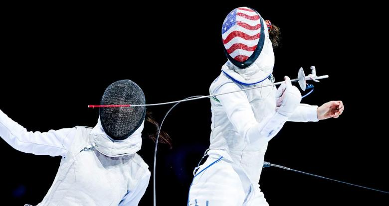 Canadian Jessica Guo dodges American Lee Kiefer during the women's individual foil final at the Lima Convention Center