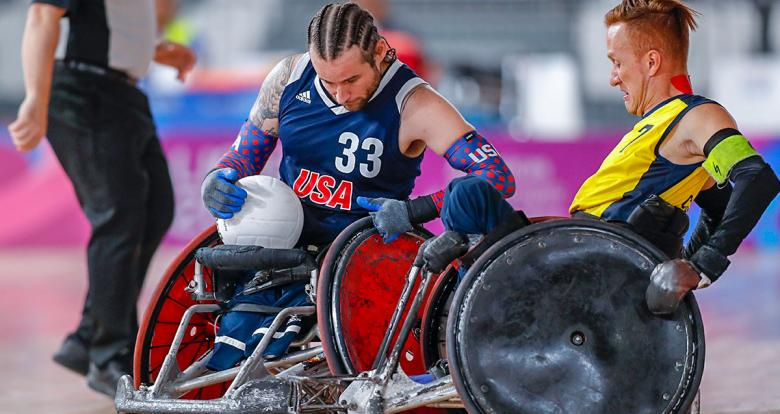 American Raymond Hennagir III goes up against Colombian Carlos Neme in the Lima 2019 wheelchair rugby event at the Villa El Salvador Sports Center