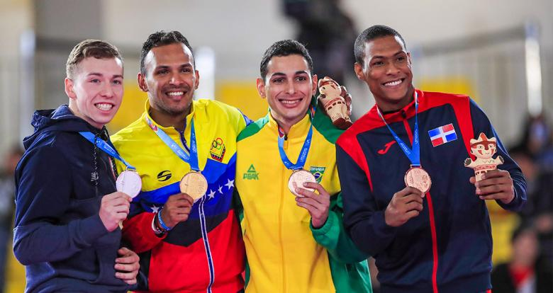 Camilo Velozo from Chile, Andrés Madera from Venezuela and Vinicius Figueira and Deivis Ferreras from the Dominican Republic show their medals for karate at the Lima 2019 Games, at the Villa María del Triunfo Sports Center.