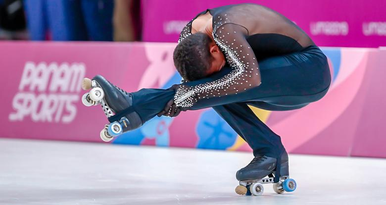 Colombia's Jairo Ortiz performs a turn during artistic roller skating exhibition