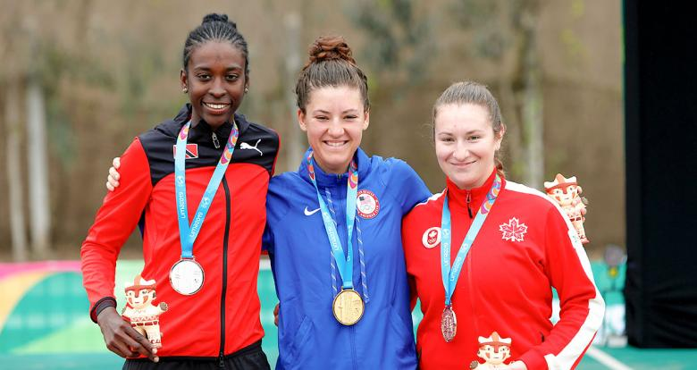 Teniel Campbell, Chloe Dygert and Laurie Jussaume celebrate with their medals at the Lima 2019 Games