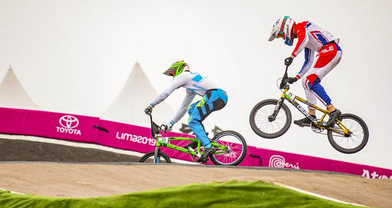Chilean rider Hernan Dodoy goes up against Guatemalan Sergio Marroquin in Lima 2019 BMX race at Costa Verde San Miguel