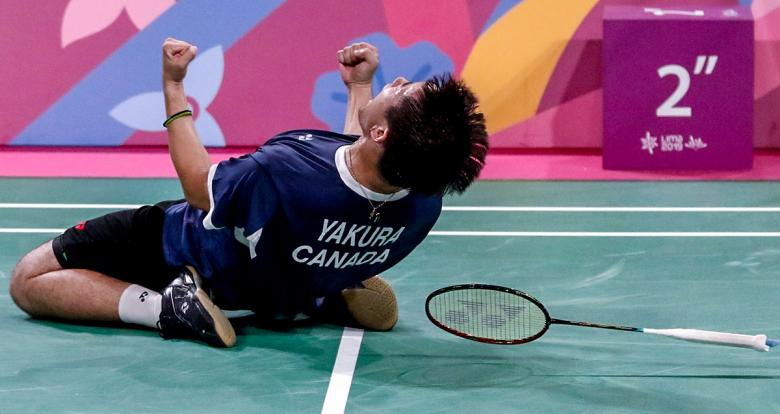 Canadian Nyl Yakura gets the gold and celebrates his victory against the United States in men's doubles badminton event held at the National Sports Village - VIDENA at the Lima 2019 Pan American Games