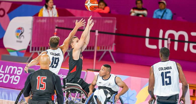 Colombian Jhon Hernandez fights for the ball against Canadian Robert Hedges during a wheelchair basketball game at the National Sports Village – VIDENA, at Lima 2019