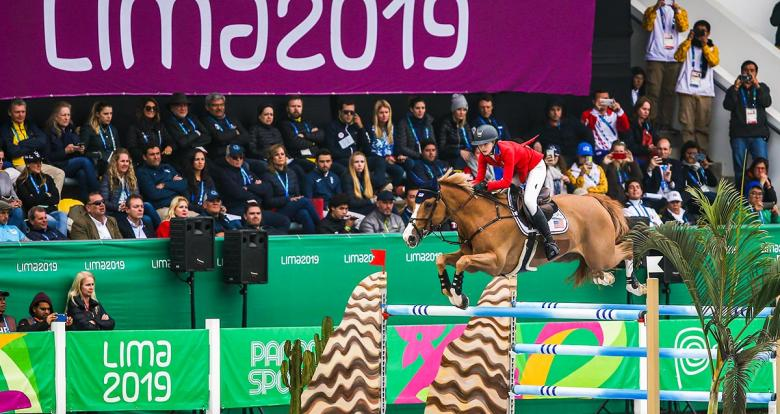 Eve Jobs of the United States jumps over an obstacle in the Lima 2019 jumping competition at the Army Equestrian School