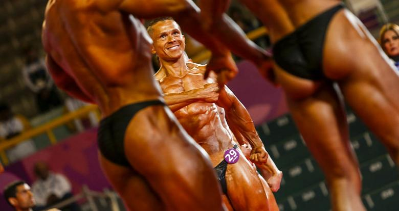 The Colombian Carlos Giraldo Barragan posing during the Lima 2019 bodybuilding competition held at the Chorrillos Military School.