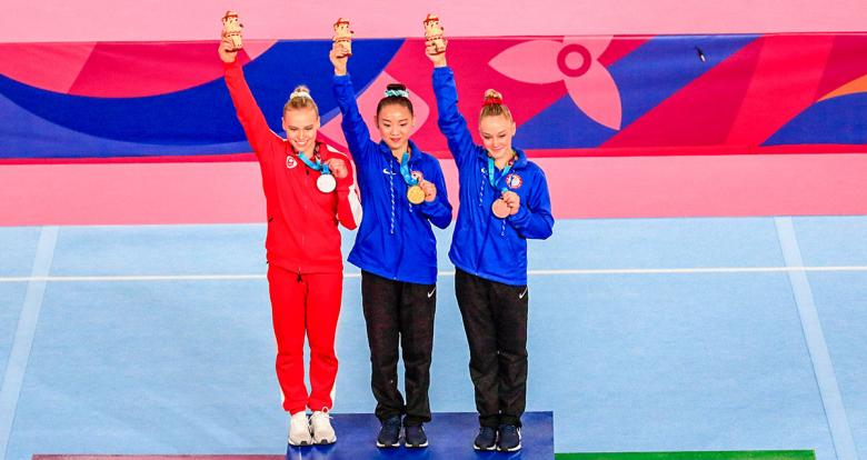 Canadian Elisabeth Black (silver), American Kara Eaker (gold) and American Riley Mc Cusker (bronze), medalists in artistic gymnastics balance beam event at the Lima 2019 Games
