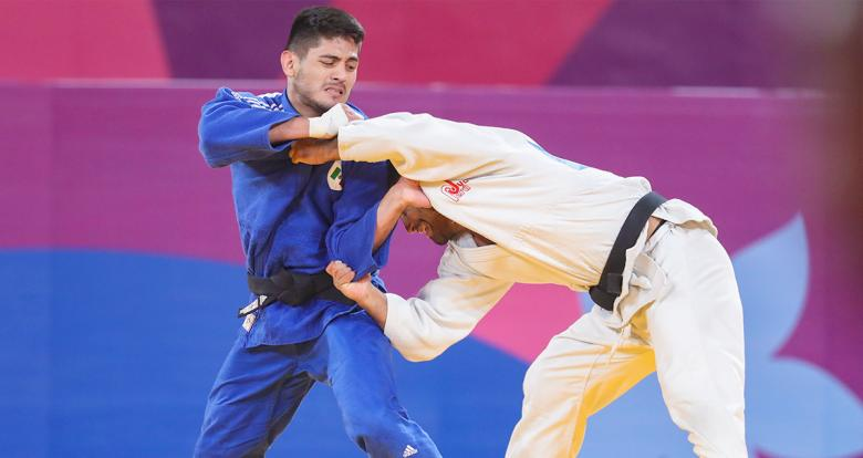 Peruvian judoka Alonso Wong goes up against Mexican Eduardo Araujo in the Lima 2019 men's -73 kg competition at the National Sports Village – VIDENA