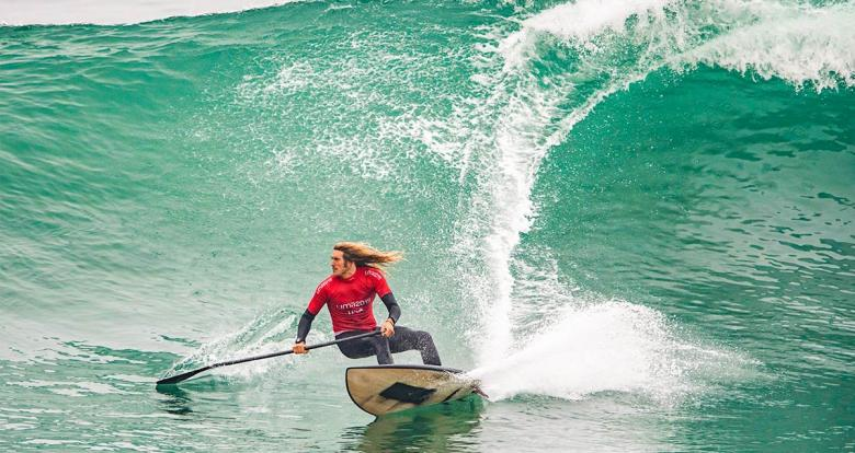 American Daniel Hughes keeping his balance on the waves in the men's SUP surfing competition at the Lima 2019 Games in Punta Rocas