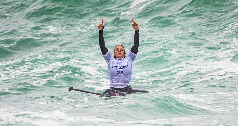 The Colombian Isabela Gomez gestures from her board in the women's SUP surfing competition at the Lima 2019 Games, in Punta Rocas