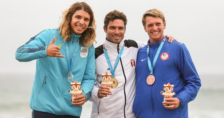 Julian Schweizer from Uruguay (silver), Benoit Clemente from Peru (gold) and Cole Robbins from the USA (bronze) celebrate their medals at the Lima 2019 Games in Punta Rocas