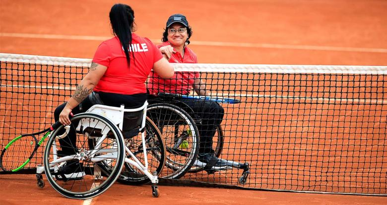 Peru's Maria Castillo and Chile's Sofia Fuentes share a smile after the Lima 2019 wheelchair tennis held at the Lawn Tennis Club
