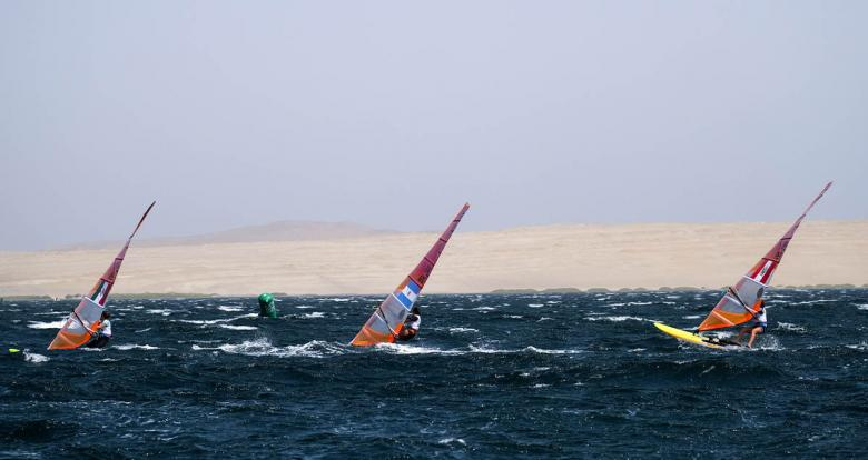 Demita Vega of Mexico, Celia Tejerina of Argentina and María Bazo of Peru compete in the Lima 2019 women's windsurf competition at Paracas Bay