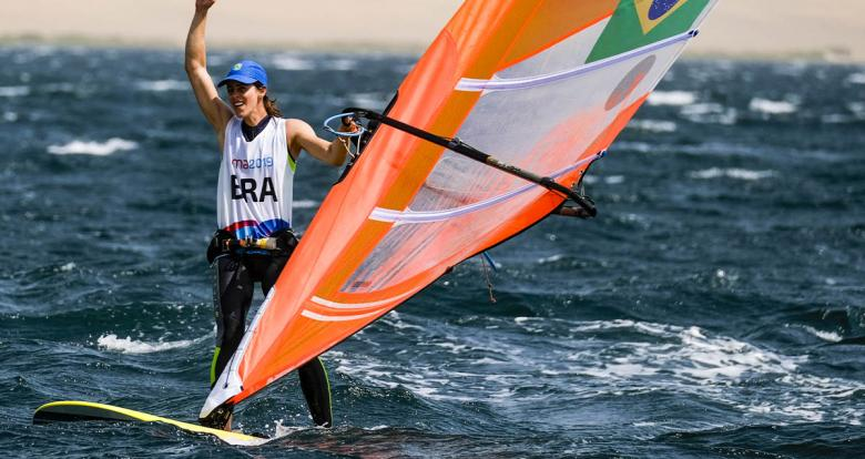 Patrícia Freitas of Brazil celebrates winning the gold medal in the Lima 2019 women's windsurf competition at Paracas Bay.