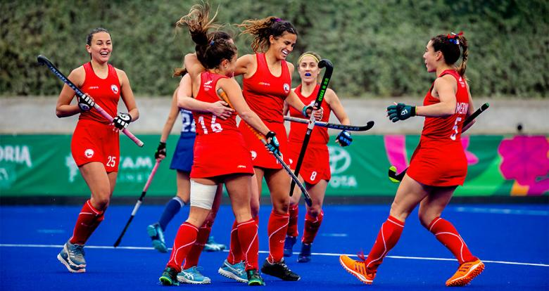 The Chilean hockey team celebrate a goal against the USA in the Lima 2019 hockey match for the bronze medal at the National Sports Village (VIDENA)