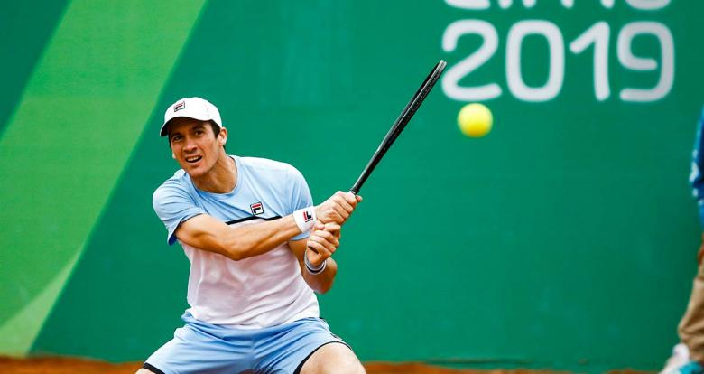 Argentinian Facundo Bagnis hits the ball during Lima 2019 tennis match against his compatriot Guido Andreozzi at Club Lawn Tennis