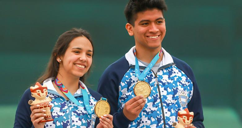 Fernanda Russo and Marcelo Gutierrez from Argentina proudly show their gold medals of the mixed 10m air rifle competition at Las Palmas Air Base, Lima 2019 Games