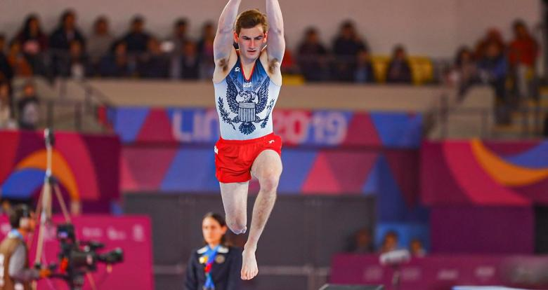 Robert Neff from the US about to jump in the men's artistic gymnastics competition at Lima 2019, in the Villa El Salvador Sports Center.