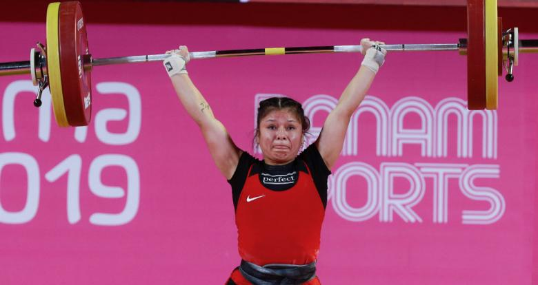 Shoely Mego from Peru competes in the women's 55 kg weightlifting event at Lima 2019 held at the Chorrillos Military School