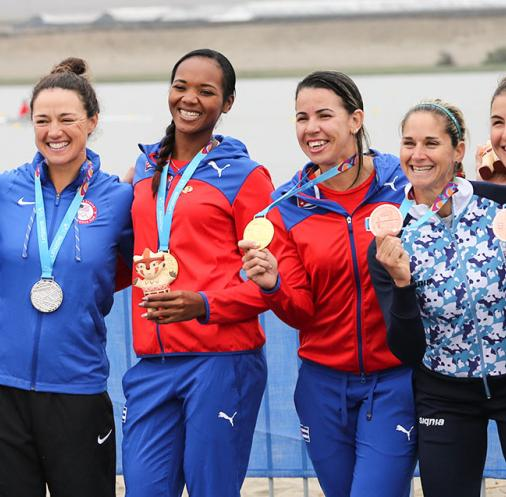 American, Cuban and Argentinian rowers show their medals at the podium in double sculls finals at Laguna Bujama