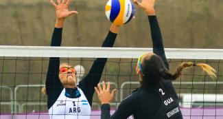 Guatemala's María Bethancourt attacks the ball - Beach volleyball