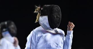 Guatemala's Maria Diéguez clenches a fist to celebrate victory in fencing event for Modern Pentathlon